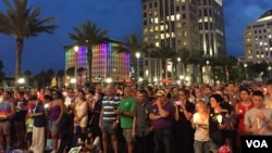 FILE - People gather outside the Dr Phillips Center for Performing Art in Orlando for a vigil for the victims and the injured of Orlando nightclub shooting. (S. Dizayee/VOA)