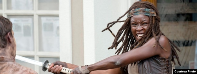 "Danai Gurira, as Michonne, fights off zombies in a scene from ""The Walking Dead."" (Photo courtesy of AMC)"