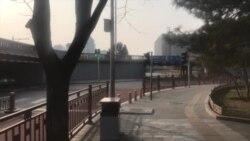 北京缓开两会催复工 返程旅客惧谈政治