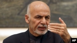 FILE - Afghan President Ashraf Ghani speaks during a press conference at the presidential palace in Kabul, Dec. 31, 2015.