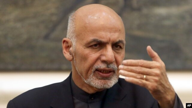 FILE - Afghan President Ashraf Ghani speaks during a press conference at the presidential palace in  Kabul, Dec. 31, 2015. Ghani said on March 6, 2016, his security forces have uprooted loyalists of Islamic State in the country.