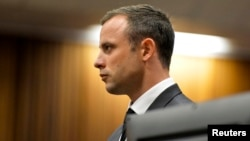 Olympic and Paralympic track star Oscar Pistorius stands in the dock during his trial at the North Gauteng High Court in Pretoria, South Africa, March 3, 2014.