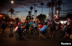 Migrants, part of a caravan of thousands traveling from Central America en route to the United States, make their way to Tijuana from Mexicali, Mexico, Nov. 20, 2018.