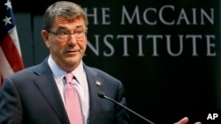 "U.S. Secretary of Defense Ashton Carter prepares to speak about the so-called ""Asia Pivot"" by the U.S., at the McCain Institute at Arizona State University, April 6, 2015, in Tempe, Arizona."