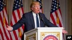 FILE - Republican presidential candidate Donald Trump speaks during the Palm Beach County GOP Lincoln Day Dinner at the Mar-A-Lago Club in Palm Beach, Florida, March 20, 2016.