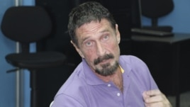 In this image released by Guatemala's National Police, software company founder John McAfee is pictured after being arrested for entering the country illegally in Guatemala City, December 5, 2012.
