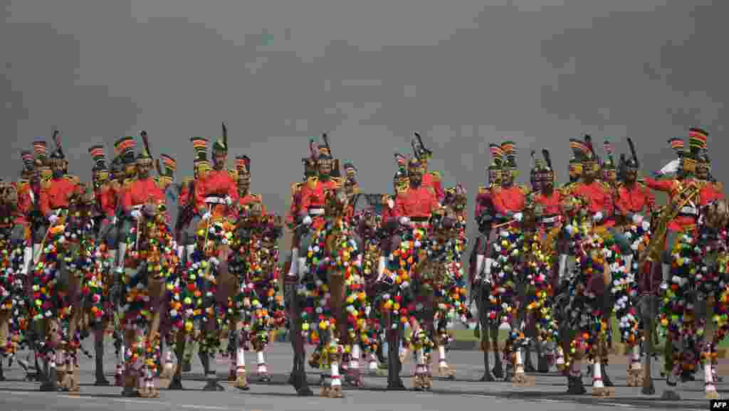 A Pakistani camel-mounted military band performs during a Pakistan Day military parade in Islamabad.