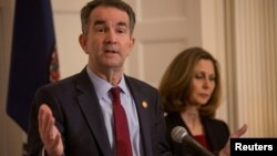 FILE - Virginia Governor Ralph Northam, accompanied by his wife Pamela Northam, announces he will not resign during a news conference Richmond, Virginia, Feb. 2, 2019.