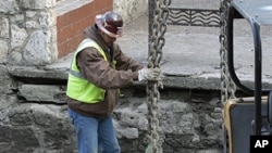 A worker does his job along the San Antonio River Walk in San Antonio, Texas, after the river was drained to clean out silt and make repairs, Jan. 7, 2011