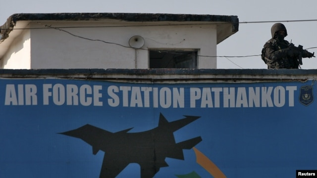 An Indian security personnel stands guard on a building at the Indian Air Force (IAF) base at Pathankot in Punjab, India, Jan. 5, 2016.