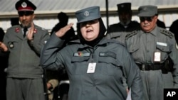 An Afghan policewoman salutes after receiving certification during a graduation ceremony, Herat, Jan. 10, 2013.