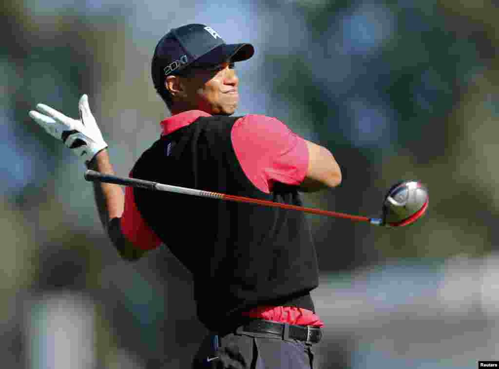 U.S. golfer Tiger Woods lets go of his driver on his follow through while hitting off the 9th tee during final round play at the Farmers Insurance Open in San Diego, California, January 28, 2013.