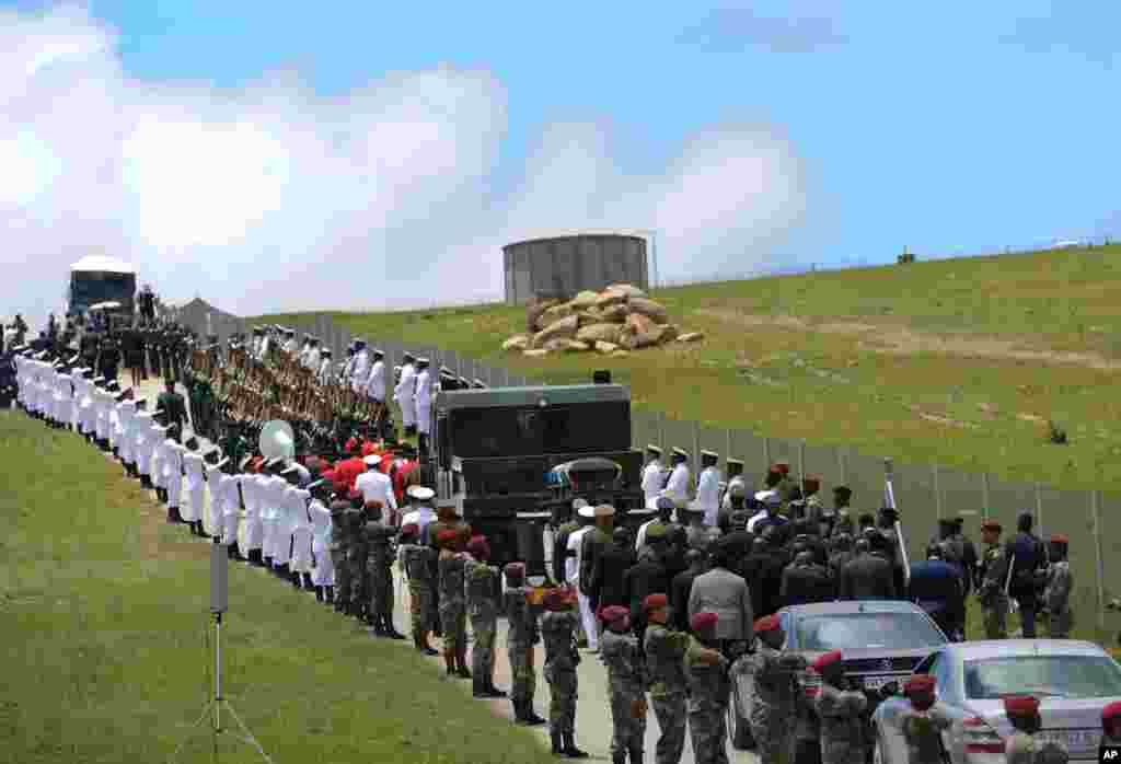 Military personnel line the route as former South African President Nelson Mandela's casket is taken to its burial place in Qunu.
