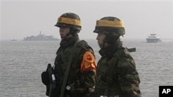 South Korean marines stand guard on Yeonpyeong Island, South Korea, Dec. 17, 2010