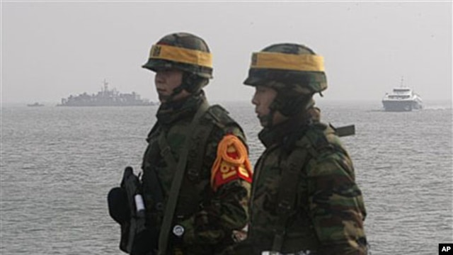 South Korean marines stand guard on Yeonpyeong Island, South Korea, 17 Dec 2010