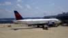 FILE - A Delta Airlines passengers plane just arrived at the Ronald Reagan-Washington National airport, just outside Washington, DC. (VOA/Diaa Bekheet)