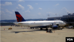 FILE - A Delta Airlines plane parks at the Ronald Reagan-Washington National airport, just outside Washington, DC. Airlines, airports and air traffic management companies are sharing more information than ever before to make flying more efficient. (Photo: Diaa Bekheet)