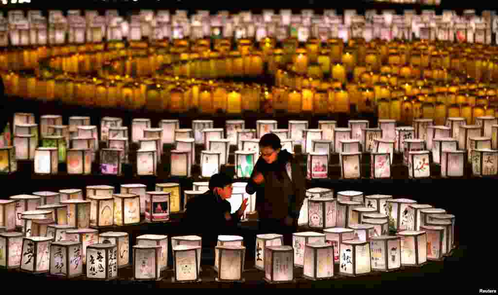 Thousands of lanterns are lit up to mourn for the victims of the March 11, 2011 earthquake and tsunami in Natori, Miyagi Prefecture, Japan, in this photo taken by Kyodo, ahead of the four-year anniversary of the disaster.