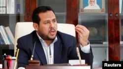 FILE - Abdul Hakeem Belhadj, leader of the Al-Watan party, speaks during an interview with Reuters in Tripoli, March 4, 2015.