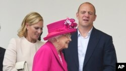 Queen Elizabeth II leaves with Zara and Mike Tindall during the Patron's Lunch in The Mall, central London in honor of the her 90th birthday, June 12, 2016.