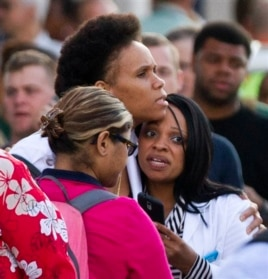 Family and friends wait to greet Navy staff as they are bused to Nationals Park, in Washington, Sept. 16, 2013.