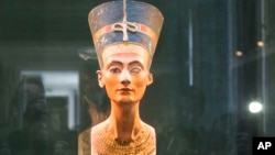 FILE - A bust of ancient Egyptian Queen Nefertiti at the New Museum in Berlin, Sept. 10, 2014.