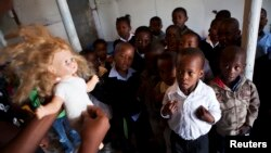 A volunteer from Simelela teaches children how to protect themselves at a school in South Africa.