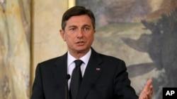 FILE - Slovenian President Borut Pahor speaks during a news conference after talks with Austrian President elect Alexander van der Bellen in Vienna, Austria, Jan. 10, 2017.