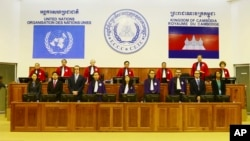 In this photo released by the Extraordinary Chambers in the Courts of Cambodia, Judges and clerks of the U.N.-backed war crimes tribunal are standing inside the court hall of the U.N.-backed war crimes tribunal in Phnom Penh, file photo.
