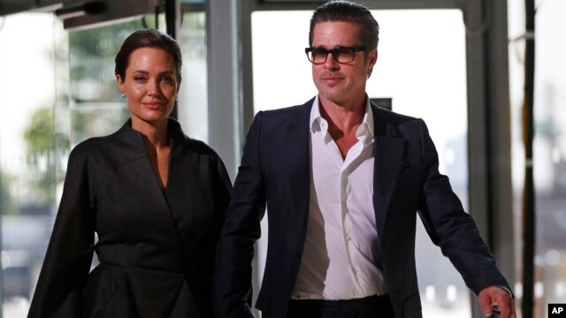 FILE - U.S. actress Angelina Jolie and partner actor Brad Pitt.