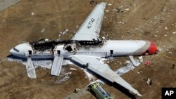 FILE - In this July 6, 2013 aerial file photo, the wreckage of Asiana Flight 214 lies on the ground after it crashed at the San Francisco International Airport in San Francisco.