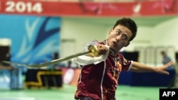Sun Peiyuan saat tampi di final nomor daoshu putra di Asian Games 2014, di Incheon, Korea Selatan, 21 September 2014.