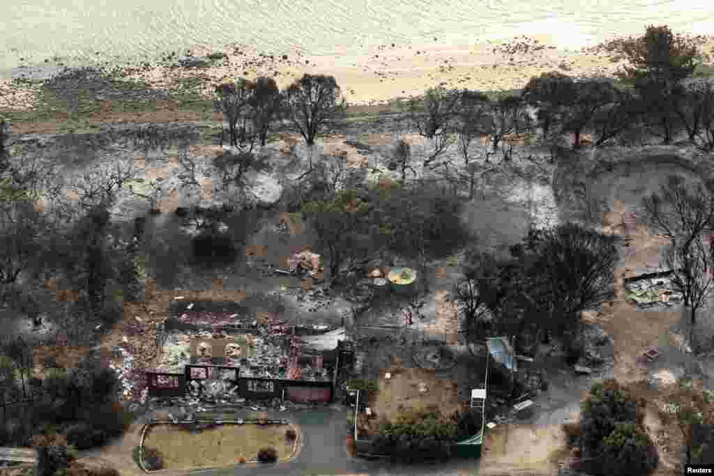 Houses destroyed by a wildfire are seen in ruins in Dunalley, east of Hobart, Australia, January 5, 2013.