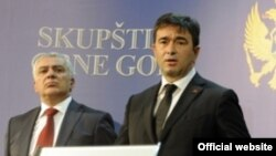 FILE - Opposition leaders Andrija Mandic and Nebojsa Medojevic are shown in March 2013.