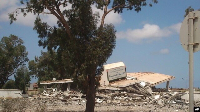 A collapsed criminal evidence building after an attack by Islamic hard-line militias in Benghazi, Libya, Aug. 1, 2014.