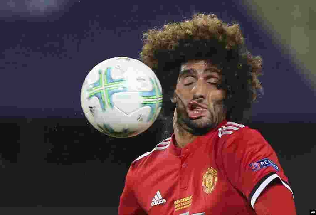 Manchester United's Marouane Fellaini heads the ball during the UEFA Super Cup final soccer match between Real Madrid and Manchester United at Philip II Arena in Skopje, Macedonia, Aug. 8, 2017.