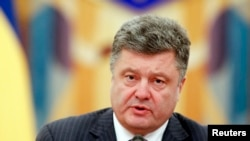 FILE - Ukrainian President Petro Poroshenko takes part in a meeting of the security council in Kyiv, June 16, 2014.