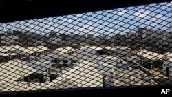 FILE - A view through a mesh window looks out over part of Aden Central Prison, known as Mansoura, in Aden, Yemen, May 9, 2017.