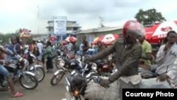 FILE - Liberian motorcyclists.