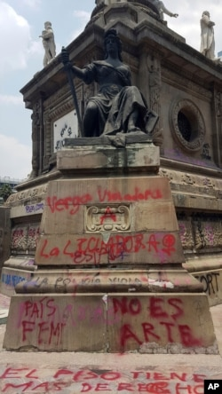 Grafitti covers Mexico City's iconic Angel of Independence, after protesters defaced it, in Mexico City, Saturday, Aug. 17, 2019. Protests erupted in the capital this week over a perception that city officials were not adequately investigating…