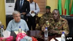 United Nations Secretary-General Antonio Guterres (L) sits next to Malian Army General Didier Dacko, Force Commander of the G5 Sahel, an institutional framework for coordination of regional cooperation in development policies and security matters in West Africa, in Sevare on May 30, 2018, during Guterres' two-day visit to Mali.