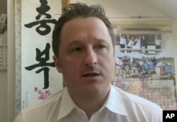 IFILE - An image made from video on March 2, 2017 shows Michael Spavor, director of Paektu Cultural Exchange, talking during a Skype interview in Yangi, China.