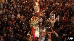 Похорони жертв нападу екстремістів на католицьку церкву в Багдаді.