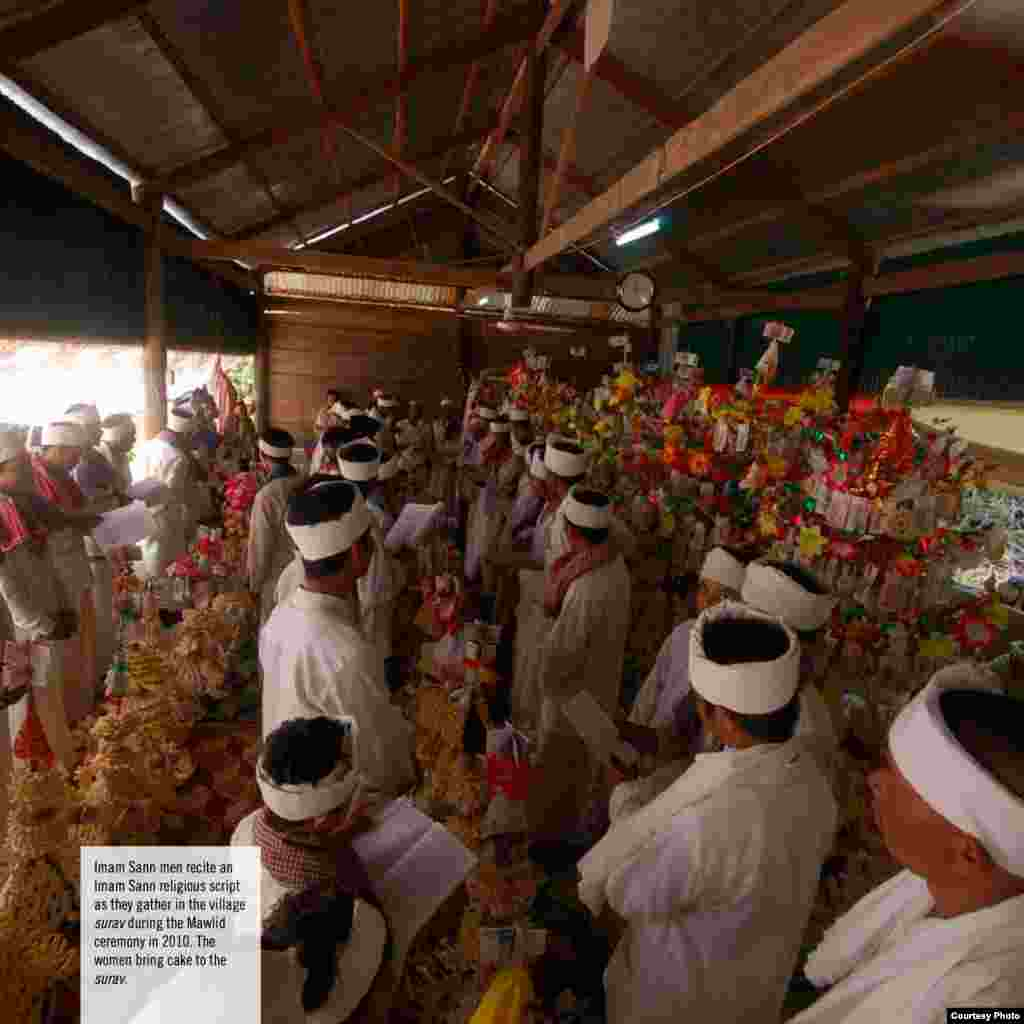 Imam Sann men recite an Imam Sann religious script as they gather in the village surav during the Mawlid ceremony, 2010. The women bring cake to the surav.(Courtesy photo of DC-Cam)
