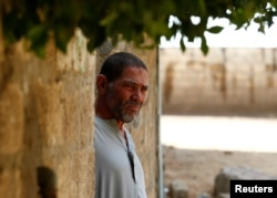 The father of Ibrahim Abushusha, a 26-year-old man who worked as a day laborer and one of at least 22 Egyptians found dead earlier this month after trekking through the Libyan desert, looks on in the village of Tarfa al-Kom in Minya province, Egypt, July 12, 2017.