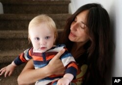 FILE - Fulvia Serra and her husband, Scott, are raising their 1-year-old son, Sebastiano, vegan. Despite criticism and innuendo from some circles, pediatricians and nutritionists agree it's perfectly healthy to feed babies a vegan diet.
