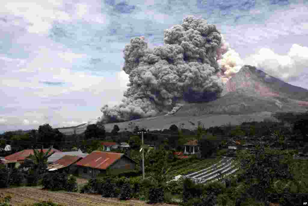 Mount Sinabung releases pyroclastic flows seen from Tiga Serangkai, North Sumatra, Indonesia. Mount Sinabung, among about 130 active volcanoes in Indonesia, has sporadically erupted since 2010 after being dormant for over 400 years.