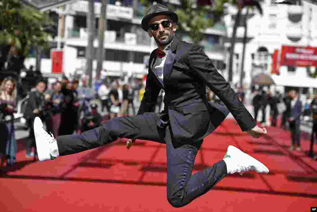 Director JR poses for photographers upon arrival at the screening of the film Visages, Villages, at the 70th international film festival, Cannes, southern France.
