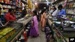 Indian people shop at a store in Mumbai, India, Friday, Sept. 14, 2012.