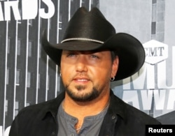 FILE - Country music singer Jason Aldean poses at the 2017 CMT Music Awards in Nashville, Tennessee, June 7, 2017.